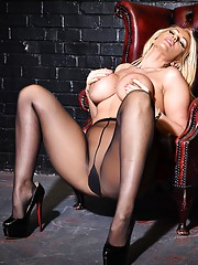 Stunning busty blonde Milf Lucy Zara is teasing in a pair of silky nylon pantyhose