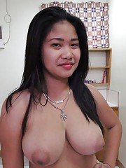 Big-tittied Asian with puffy nipples loves riding white cock