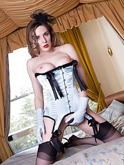 Samantha is ready to play on the four poster dressed for nylon fun and games.