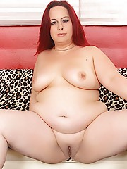 Have a look at this redheaded plumper as she gets naked and fingers herself