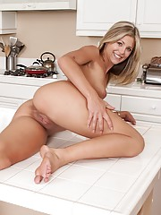 Stunning blond Scarlet Red fingers her tight pussy.