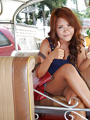 Sexy Thai babe with killer smile stripping nude