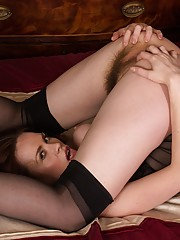 Older redhead Mistique spreads her beautiful ass.