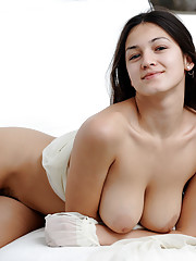 Sofi A beautiful in white showing off her dark hairy pussy and very dark full labia