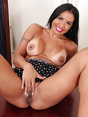 Latin MILF Marisa Mendes exposes her big tan lined breasts.