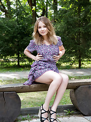 Jeff Milton is sitting pretty as a picture on a bench in her pretty floral dress