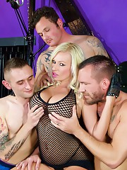 Watch Michelle Thorne in leather boots and gloves sucking three cocks before getting