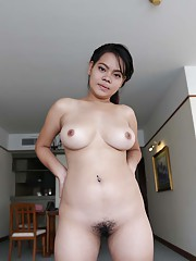 Chubby Thai babe with beautiful heavy-hangers showing off her curves