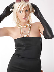 A very elegant blonde babe wearing gorgeous black dress and sexy leather gloves