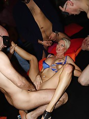 Sexy US swinger MILF Emma Starr joined some British guys for a gangbang