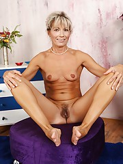 Country cougar Janet Darling tickles her own g-spot.