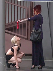 Nora Barcelona is humiliated in a rainy Barcelona square before being brought to