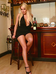 The very sexy Dannii Harwood has popped her cork and is enjoying a bottle of champagne