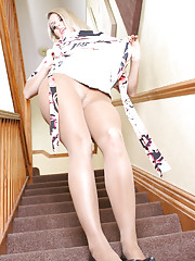 Blonde babe Dannii Harwood takes you on a journey down her stairs and upskirt! Watch