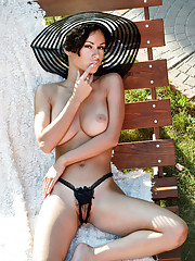 With the bright sun shine Pammie Lee sensually strips off her deep elegant black