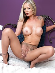 Roxi on the bed in masculine shirt and sheer pantyhose!