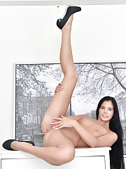 Cock hungry amateur shows off her long legs and teases her tiny pink clit