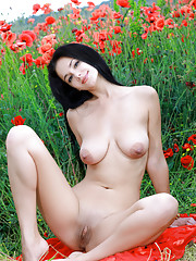 Leona E displays her large breasts in a field Russian Federation