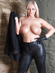 Blonde bombshell Charley with huge tits shows off her leather covered fingers and