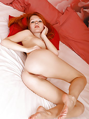 Mia is one sexy redhead you would want to be on top of your bed when you come from