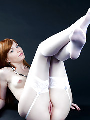 White thigh-high stockings and a matching lace garter belt amplifies Jo39s innocent