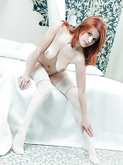Sultry redhead Violla A with smooth porcelain skin and exciting pink and smooth assets