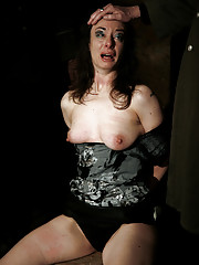 Nadja a wild prostitute has been caught and imprisoned. She wakes up bound to a chair