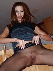 Eufrat is in the kitchen wearing a sexy black dress with black pantyhose and sexy