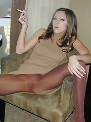 Kiera King is a bad girl sitting in her chair with her legs open smoking a cigarette