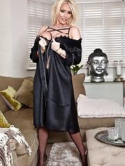 A classic black silk robe and silky stockings for Lucy Zara to get all horny wearing
