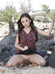Li Moon undresses amidst the ruins and shows off her juicy Asian ass