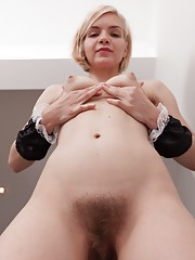 Baibira is a sexy housekeeper today and she poses seductively in her uniform. As