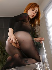 Sexy redhead pees into a goblet and drinks it