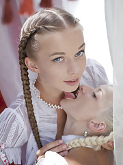 Two alluring damsels with the face of an angel pretty braided hair and delightfully