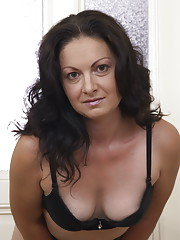 This cute housewife loves to strip and tease