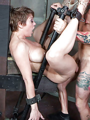 Angel Allwood is tied to the Sybian with her mouth at the perfect height for use.