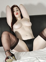 Hot curvy redhead babe Jay is topless on her bed and teasing in a pair of black panties