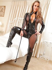 Mistress Emma K in a PVC and mesh catsuit plays with slave letting him look but not