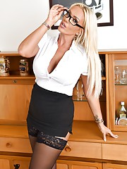 Sexy old school office set with busty blonde Lucy Zara looking as horny as ever in