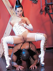 Carmen loves her white latex outfit and her black stallions