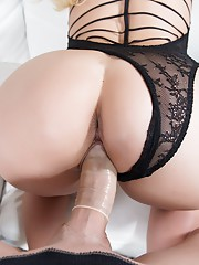Miss Love is wearing a beautiful sexy one peace lingerie and she starts sucking on