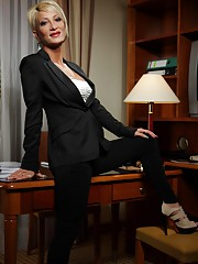 Chesty elegant blonde office babe showing her hot assets