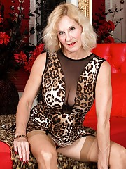 Molly Maracas strips off leopard print dress and fingers mature box.
