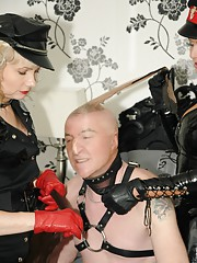This slave gets the pleasure of serving two dommes dressed in sexy uniforms who cuff
