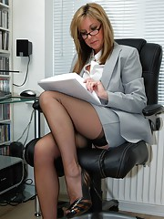 Jayde is hard at work in the office dressed in her business suit with a very short