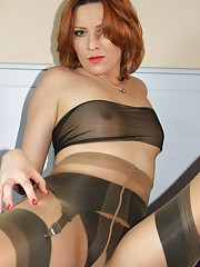 Vixens love of nylon is taken to another level as she encases herself in nylons and