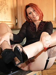 Fun in the kitchen while Vixen prepares dinner. Do you like her short skirt... when