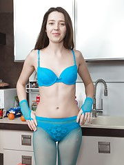 Lisa Carry has tight blue tights on in her kitchen and slides them off with her blue