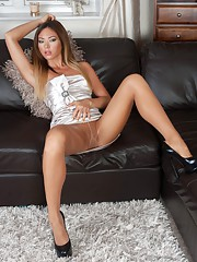 Heres Natalia in a pair of shiny sheer pantyhose high class designer heels and a