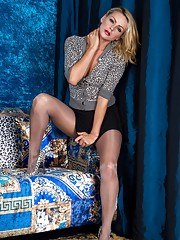 Luscious blonde Vanessa gets horny in a special pair of pantyhose glossy grey with